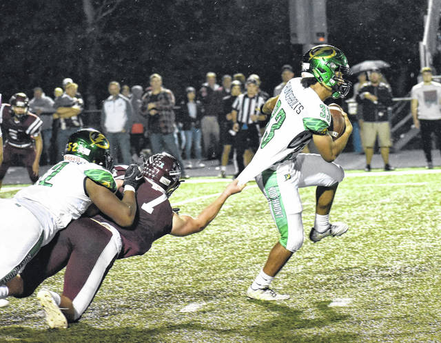 <strong>Michael Franklin picks up yardage while Lebanon linebacker Mason DeGennaro tries to drag him down by his jersey.</strong>