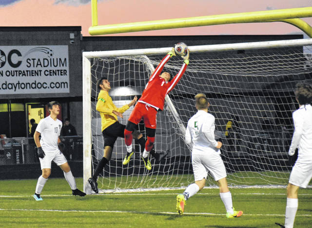 <strong>Northmont goalkeeper Nick Newman leaps high to make a save on Centerville's first shot on goal.</strong>
