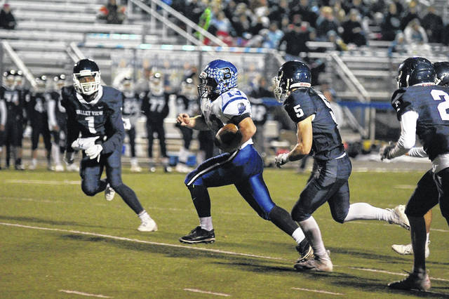 Brookville senior running back Connor Michael is being pursued by several Valley View defenders in last Friday's football game, played in Germantown. Michael led the Blue Devils with 113 yards on the ground in a 35-0 victory by the Spartans over Brookville.