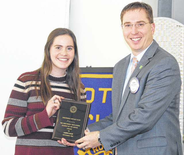 <strong>Lauryn Zilles is shown receiving her Northmont Rotary Student of the Month award from Northmont High School Principal Dr. Jason Inkrott.</strong>