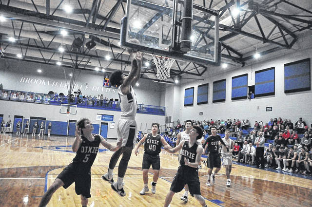 Brookville's Manny Willis, a senior, is shown dunking the basketball over Dixie's Logan Grubb and Jordan Butt. Brookville won the rivalry game 60-39.