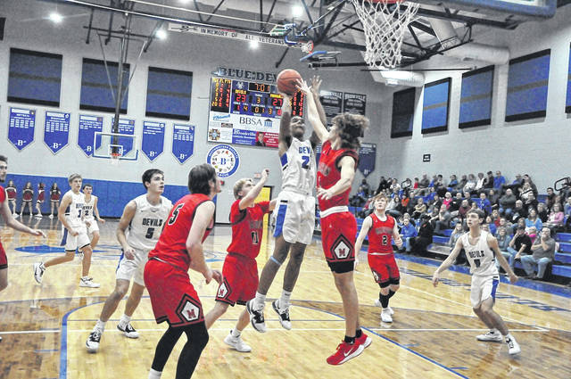 Brookville's Manny Willis goes inside for this shot attempt during a boys' basketball game against Middletown Madison on Dec. 14. He scored eight points in the Blue Devils' 55-47 loss to the Mohawks. The Blue Devils will be in action this coming weekend at the Franklin-Monroe Jet Holiday Tournament.