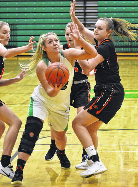 <strong>Gabby Kline splits Beavercreek defenders Maci Rhoades (left) and Anna Landing to score inside the paint.</strong>