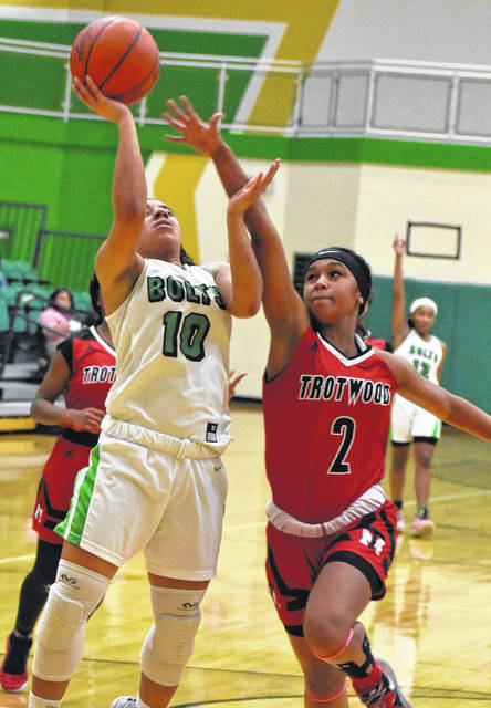 <strong>Kaitlyn McCrary scores a first quarter layup off a steal as Jaylen Dixon tries to block the shot.</strong>
