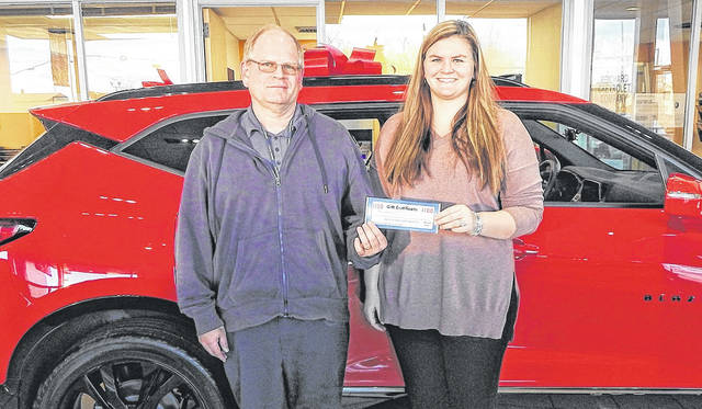 Jeff Stose (left) of Clayton was the winner of the week 14 Brookville Star Football Challenge. He is shown collecting his prize from Paige Reichard of Reichard Chevrolet in Brookville. Reichard Chevrolet was the Sponsor-of-the Week for the contest.