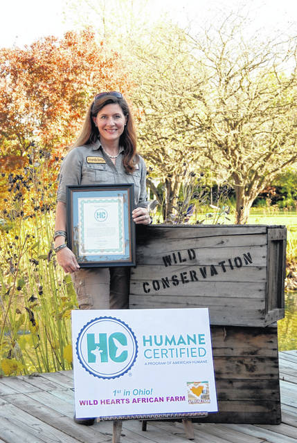 Amanda Badger is shown with the new awards her Wild Hearts African Farm, an educational facility and agritourism destination in Lewisburg, has recently received.