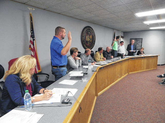 The members of Brookville City Council who won re-election to their seats in November were all sworn-in for new terms at the Jan. 7 council meeting. Shown taking the oath form Brookville Law Director Rod Stephan (far right) are, from left, JD Fowler, Matthew Swabb and Stephen Crane.