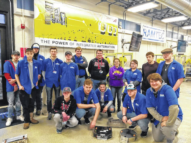 These Miami Valley Career Technology Center Robotics and Automation students competed in the Xtreme Bots Competition on Saturday, Dec. 7 at the Wright State University Nutter Center. They are shown with the robots they built for the event.