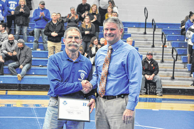 Longtime Brookville wrestling coach Pete Chakiris (left) was recently honored by Brookville High School for his long tenure in assisting the Brookville wrestling teams. He is shown with his honor with Brookville Superintendent of Schools Tim Hopkins.