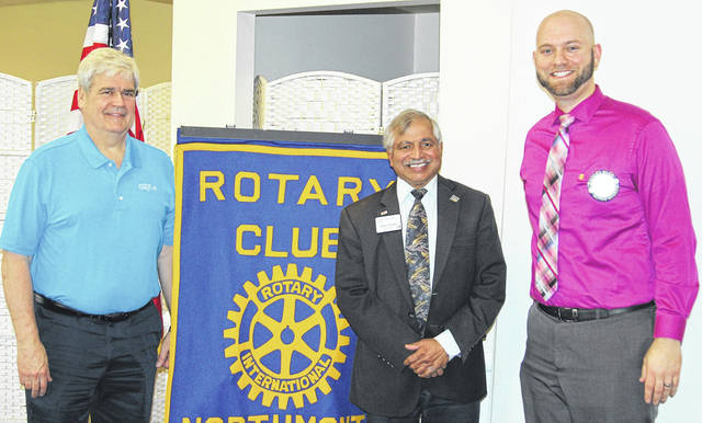 <strong>Shown with Sham Reddy (center) is Clayton Mayor (and Rotarian) Mike Stevens (left) and Rotary President Brad Rarick (right).</strong>