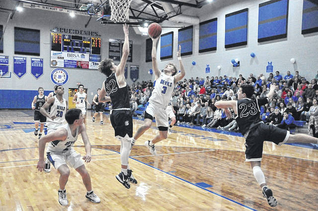 Brookville junior AJ Eller (3) shoots over Valley View junior Troy Coulter (32) during this past Friday's boys' basketball game played at Brookville High School. Eller scored 22 points in the Blue Devils' 53-52 win.