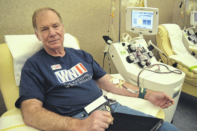 Cecil Warriner is shown making his milestone 300th blood donation.