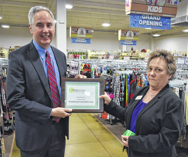 <strong>Goodwill Easterseals Miami Valley President & CEO Lance Detrick receives a framed chamber membership certificate from Northmont Area Chamber of Commerce CEO Cathy Hutton prior to the ribbon cutting ceremony.</strong>
