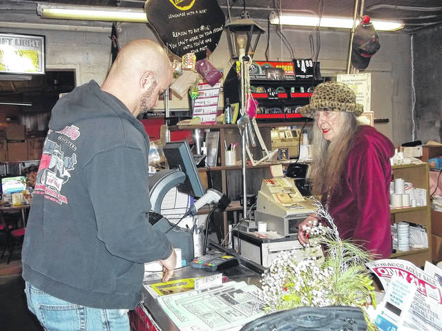 """Rose Gunkel waits on Skyler Hawley, one of the customers who showed up during a snowstorm to clear snow for her and make sure she got home safely. """"She's the greatest, most caring person,"""" he said. """"She always puts a smile on your face."""""""