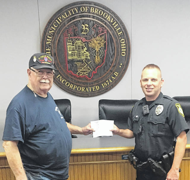 Brookville Police Department Captain Jason Jacobs accepts a check from Brookville VFW Post 3288 Commander, Paul Griffiths. The contributions from the VFW and AMVETS Post 1789, along with the Ohio Law Enforcement Body Armor program, enabled the Brookville Police Department purchase new vests for all of the department's officers.