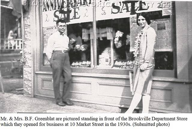 <strong>Mr. & Mrs. B.F. Greenblat are pictured standing in front of the Brookville Department Store which they opened for business at 10 Market Street in the 1930s.</strong>