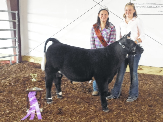 Lindsey Worley's beef feeder was named the 2015 Beef Feeder Reserve Champion Tuesday evening at the sales arena during the Fayette County Junior Fair Beef Feeder Show. She is pictured here with Beef Queen Sydney Miller.