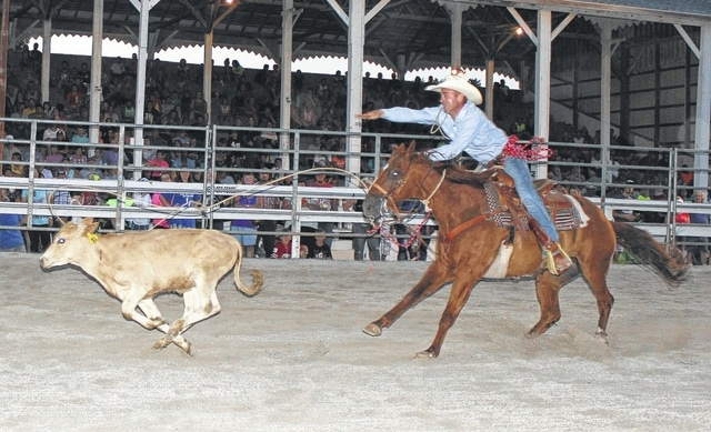 The Broken Horn Rodeo drew a near capacity crowd to the McDonald's Grandstand Saturday night at the Fayette County Fair. Above, a cowboy competes in the calf-roping competition.