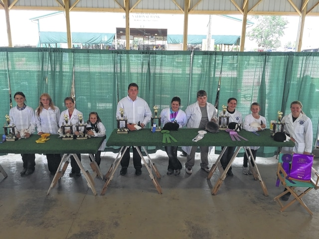 Pictured from right to left are the contestants in the overall showman category during Monday morning's rabbit showmanship show: Alexis Schwartz, Lyndsey Stump, Aubrey Schwartz, Derek Hall, Abi Mick, Dylan Page, Laurel Marting, Kassidy Hoppes, Kaitlyn Woods, and Hillery Jacobs.