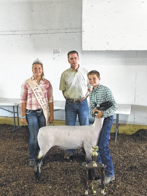 Austin Etzler and his Shropshire Lamb were named Reserve Champions in the Market Lamb show during Thursday's Junior Fair Sheep Show. Pictured with Etzler are 2014 Lamb and Wool Queen Abbi Pettit and Judge Curt Caplinger.