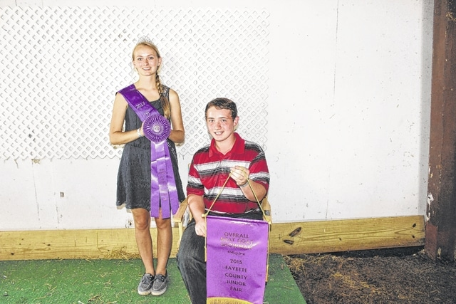 Hayden Walters won the overall meat goat showman award at Tuesday's Fayette County Junior Fair Goat Show. He is pictured with Fair Attendant Emily Daniels.