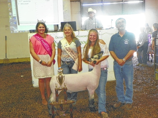 Kasi Payton's Grand Champion Market Lamb sold for $900 on Friday evening at the Fayette County Junior Fair Sheep Sale. It then resold again for an additional $250 in memory of Jim Cunningham and David Ogan, Sr. This additional money will be donated to the local 4-H and FFA clubs. Payton is pictured with fair royalty and buyers: Fair Queen Abbie Noble, Lamb & Wool Queen Abbie Pettit, and Dave Ogan, Jr. of Carroll Halliday. The lamb was resold to Robin's Nest for $250.