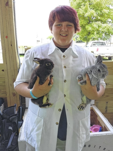 Myka Pennington won the grand champion (right) and reserve champion (left) in her rabbit class with her Netherland Dwarves.