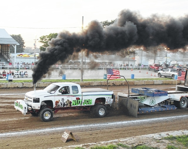 "The stock truck pull drew another very large crowd to the grandstand at the fair Friday, July 24, 2015. Above, in the diesel 3.0 turbocharger class, the truck 'Nut Job', driven by Brian Withrow of Mechanicsburg, took second place with a pull of 351' 5""."
