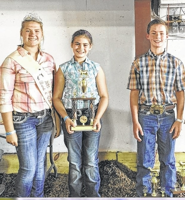Pictured from left to right are 2015 Lamb and Wool Queen Abbi Pettit, Abbi Brandt, and Cade Lindsey. Lindsey won Overall Showman in the Breeding Show and Brandt was named Reserve Showman in Thursday's Junior Fair Sheep Show.