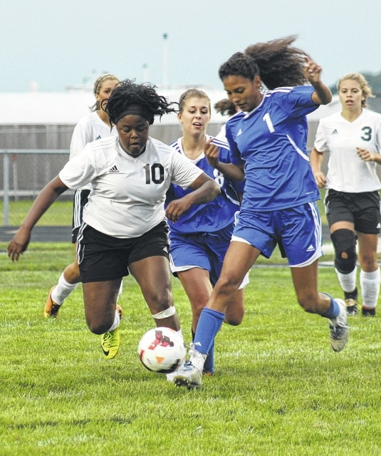 Miami Trace junior Daria Thomas (10) battles a Chillicothe player for possession of the ball during an SCOL match at Miami Trace High School Tuesday, Aug. 25, 2015.