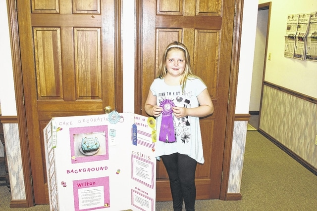 "Emily Turner, 9-years-old, won an ""Outstanding"" award for beginner cake decorator at the 2015 Ohio State Fair. This was Emily's first year in 4-H. She is a member of the Packrat Crafters. Emily is the daughter of Brad and Deborah Turner."