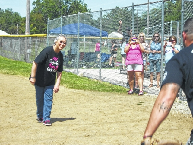 "Gloria Runnels throws out the first pitch of the 2015 ""Batting for Boobies"" softball tournament."