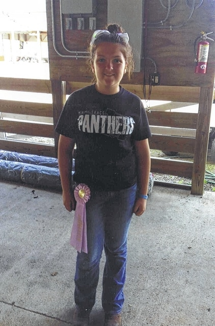 Haley Davis, with the Barn Busters 4-H Club, won the reserve champion market rabbits prize in her weight class.