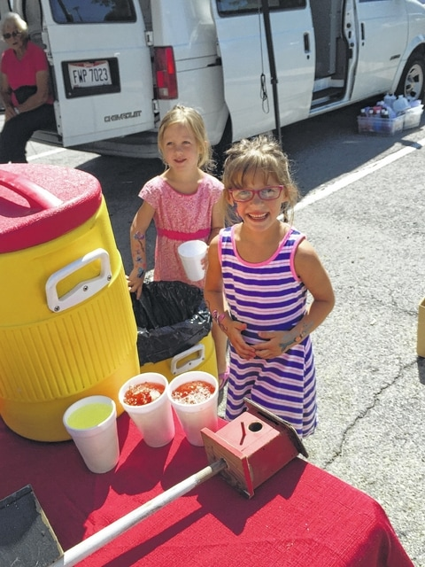 Alana and Beth help serve the beverages at the Fayette County Farmers Market.