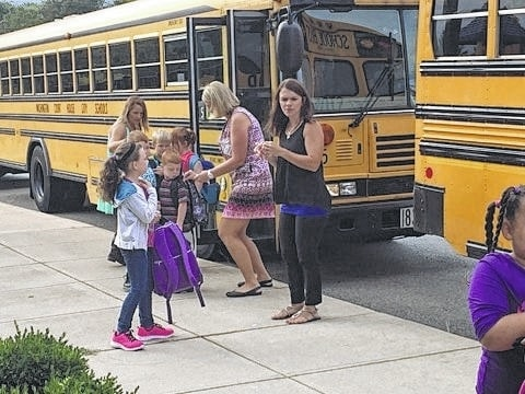 Teachers at Cherry Hill greeted students as they got off the buses Thursday morning. Each student got a sticker so that the teachers could easily make sure every child got to the correct buses to go home after the first day of school.