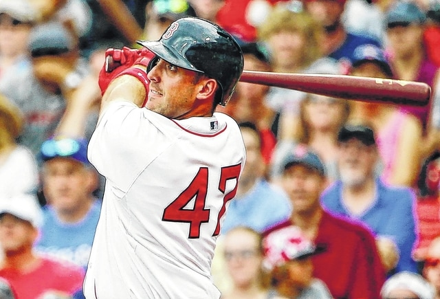 Boston Red Sox's Travis Shaw watches his second home run of the game, a two-run homer against the Tampa Bay Rays during the eighth inning of a baseball game at Fenway Park in Boston Saturday, Aug. 1, 2015.