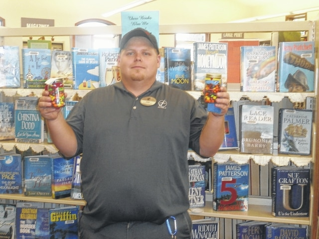 Chris Bolen was the most recent winner of Susan's Secret Sweets at Jeffersonville Branch Library. He won these two superhero candy jars filled with Skittles for guessing the correct amount in the jar.