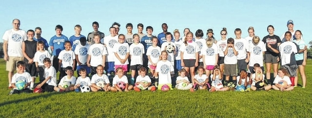 Thirty young athletes joined the Washington High School boys and girls soccer teams for youth camp July 27-30. The campers posed for this picture in between the soccer carnival and the annual Campers vs. Blue Lions scrimmage.