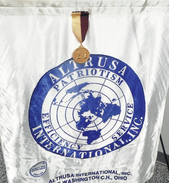 Altrusa's members recently received a medal for having contributed to Altrusa International Foundation's Club 21 program.