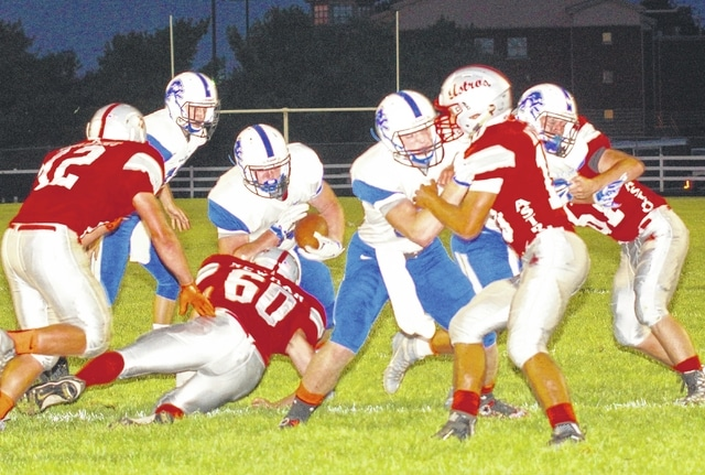 Aaron Greer carries for the Washington Blue Lions during an SCOL game at East Clinton High School Friday, Sept. 25, 2015.