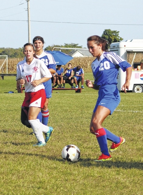 Washington's Ashley Rose (20) has control of the ball during a non-league match at Fairfield High School just outside of Leesburg Thursday, Sept. 24, 2015. The match went to Fairfield, 3-2. Also pictured for Washington is Wendy Hawk.