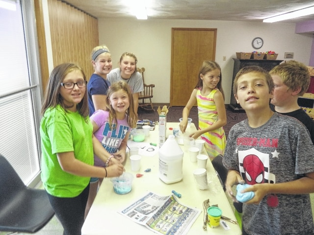 Creative kids took part in a number of activities, including this one involving slime, recently at Carnegie Public Library in Washington C.H.
