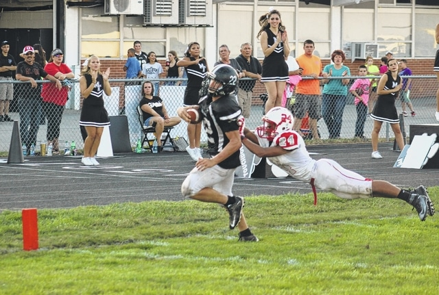 Miami Trace senior Devin Bainter (22) sheds a Carlisle defender on his way to the end zone for a 22-yard touchdown run with 4:16 remaining in the second quarter of a non-league game, the Panthers' home-opener, Saturday, Sept. 5, 2015 at Panther Stadium.