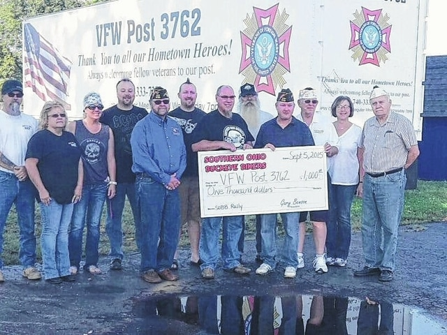 The Southern Ohio Buckeye Bike Rally (SOBBR) recently donated $1,000 to the VFW Post 3762 after a successful event. From left to right are Kenny Thacker, Brenda Thacker, Kristi Lynch, Brad Snively, Ed Wynne, DJ Jenkins, Gary Benson, Jim Morrison, Tracy Patterson, Sheldon Litton, Robin Benson and Bob Malone.