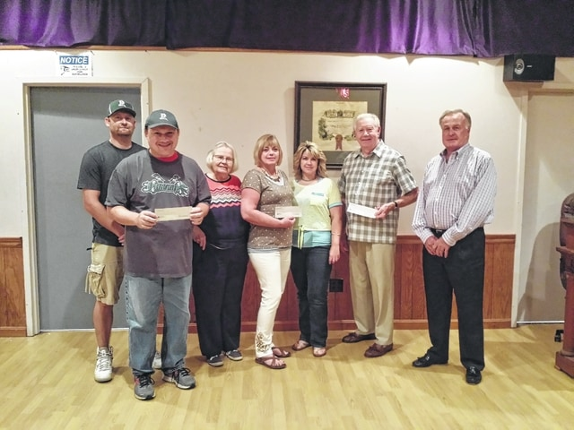 The Elks Lodge #129 recently donated to three local organizations and efforts. Pictured here (L to R): Tim Stewart, special Olympics coordinator at Fayette Progressive Industries, Chuck Stackhouse, special Olympics athlete, Marjorie See, pastor at Omega Church City of Healing, Hilda Harper, pastor, Patricia Gardner, pastor, Ed Helt, past Elks Lodge #129 president, and Roland LeMaster, Elks Lodge trustee.