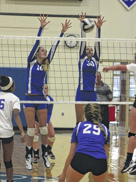 Faith Kobel, left and Hannah Haithcock go for the block for Washington during an SCOL match against Chillicothe Tuesday, Sept. 22, 2015 at Washington High School.