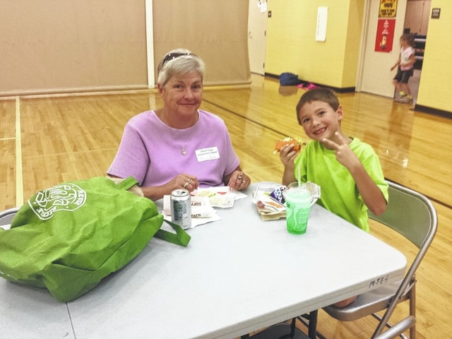 The Miami Trace Elementary School held Grandparent Week from Monday through Thursday to allow grandparents the chance to enjoy lunch at the school. Pictured here is Nancy Adams with her grandson on Thursday at the elementary school gym.