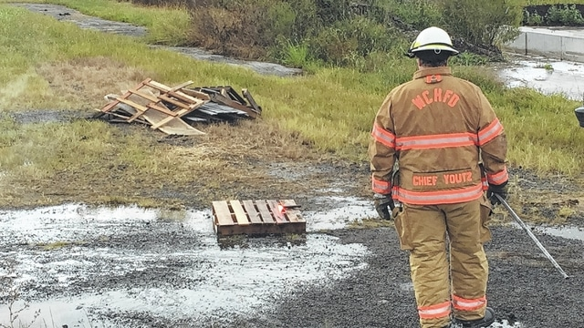 After spraying a wooden pallet with the encapsulating agent, Washington Court House Fire Chief Tom Youtz covered the pallet with kerosene and then attempted to set the pallet on fire. The pallet would not ignite.