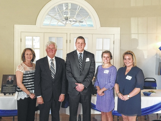 Washington Court House City Schools Superintendent Matthew McCorkle (center) stands with Justice Michael K. Randolph and his wife Kathy (left), and Maria and Kelli McDonald (right) who accepted the Hall of Fame award for their grandfather during the induction ceremony of the WCHCS Academic Hall of Fame.