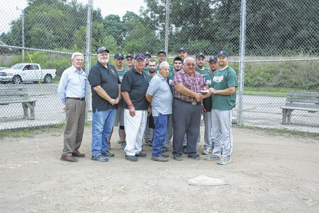 From left to right, members of the Jeffersonville Masonic Lodge #468 in attendance include: WB David Morrow, WB Larry Speck, B Jim Hobbs, B David Crawford, with WB Larry Mayer presenting the donation to recreation coordinator at Fayette County Board of DD/varsity softball coach; Tim Stewart, along with members of the 2015 Fayette County Dragons varsity softball team.